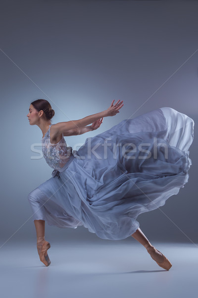 The beautiful ballerina dancing in blue long dress  Stock photo © master1305