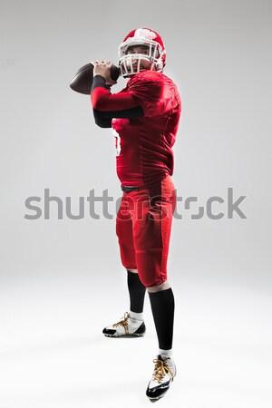 Amerikai futballista pózol labda fehér hátulnézet Stock fotó © master1305