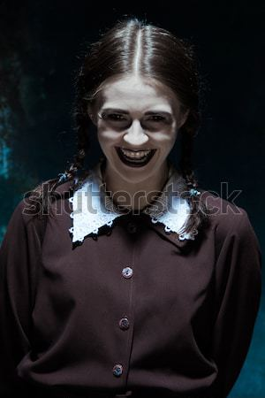 The crazy clown holding a knife on dack. Halloween concept Stock photo © master1305