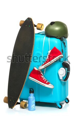 The blue suitcase, sneakers, skateboard on white background. Stock photo © master1305
