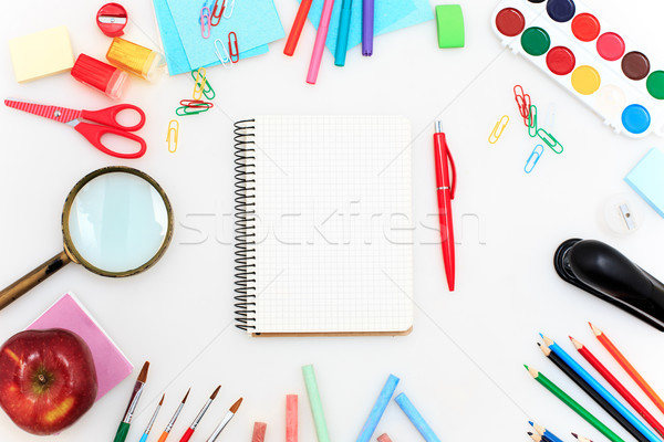 School set with notebooks, pencils, brush, scissors and apple on white background Stock photo © master1305