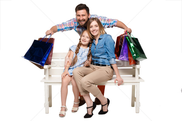 Happy family with shopping bags sitting at studio  Stock photo © master1305