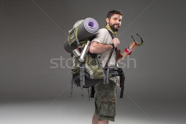 Portré mosolyog férfi turista hátizsák kamera Stock fotó © master1305