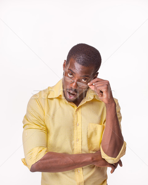 Young  black african man thinking and reminiscing about something Stock photo © master1305