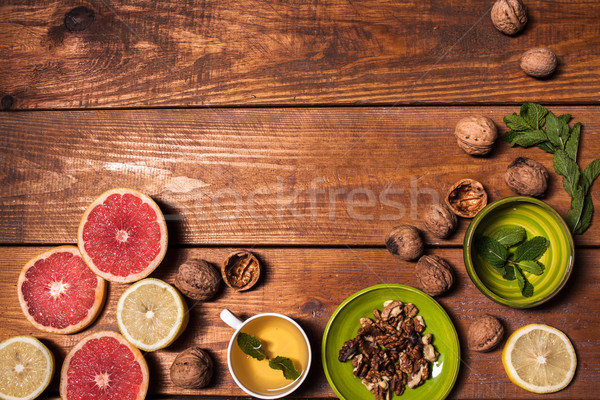 Lemon and walnut on a wooden surface close up Stock photo © master1305