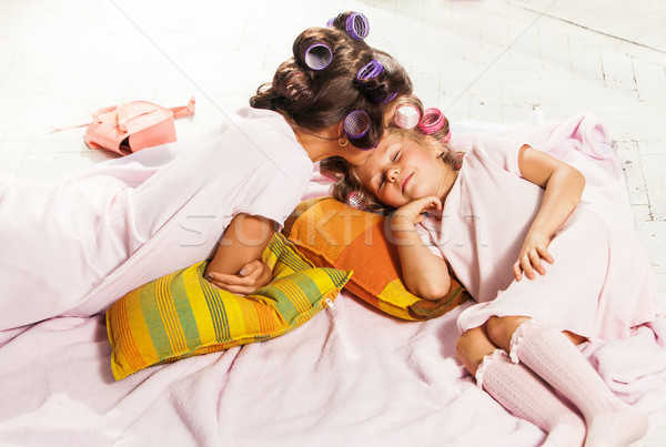 Little girl with her mother slipping in bed Stock photo © master1305