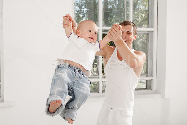 young father with his nine months old son at home Stock photo © master1305