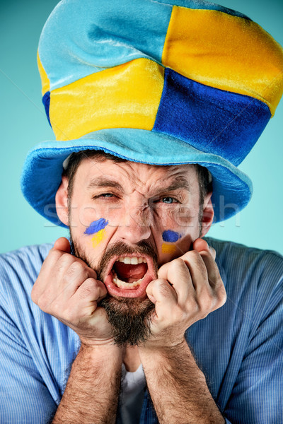 The football fan over blue Stock photo © master1305