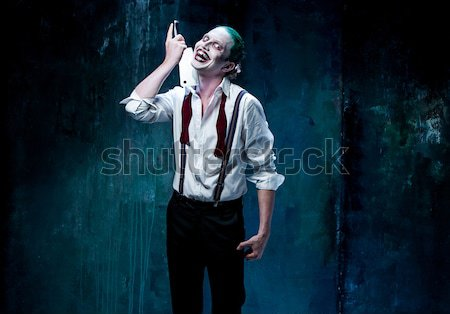 Bloody Halloween theme: crazy killer as butcher with a knife Stock photo © master1305