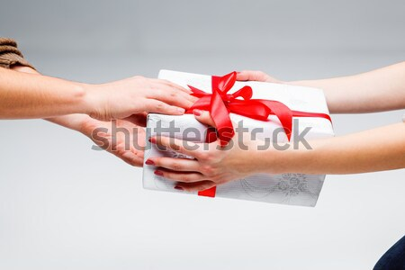 Hands giving and receiving a present Stock photo © master1305