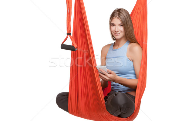 Young woman sitting in hammock for anti-gravity aerial yoga Stock photo © master1305
