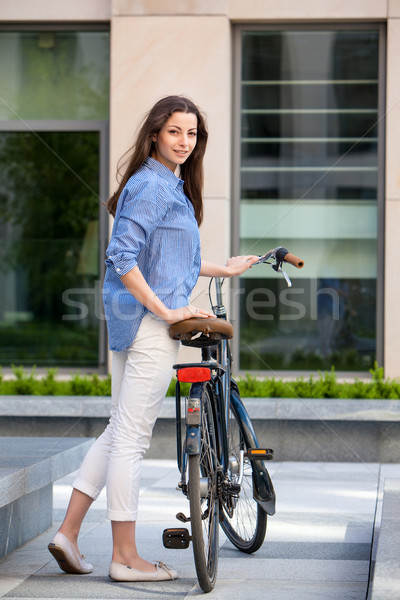 beautiful girl with a bicycle on the road Stock photo © master1305
