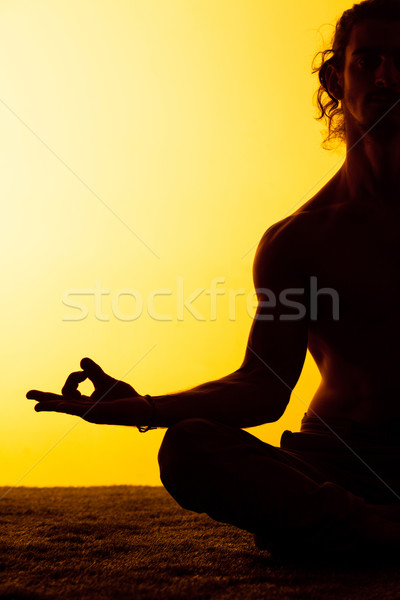The man practicing yoga in the sunset light Stock photo © master1305