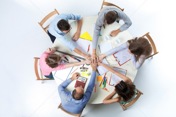 Top view. United hands of business team on workspace background  Stock photo © master1305