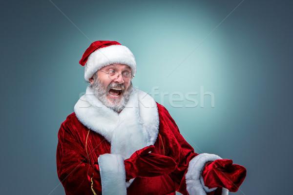 Santa Claus, presenting something. Stock photo © master1305