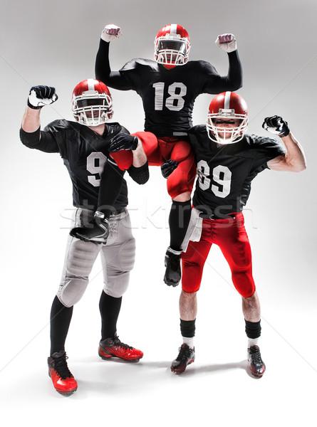Három amerikai futball játékosok pózol fehér Stock fotó © master1305