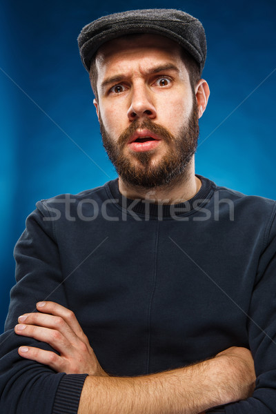 The portrait of a young beautiful surprised man  Stock photo © master1305