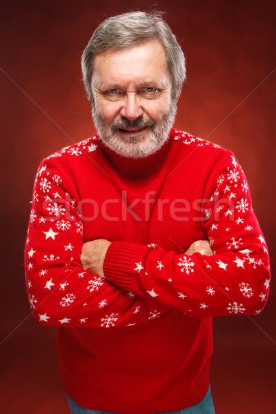 Idoso sorridente homem vermelho amavelmente suéter Foto stock © master1305