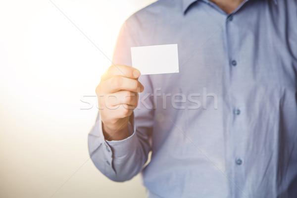 Man holding white business card  Stock photo © master1305