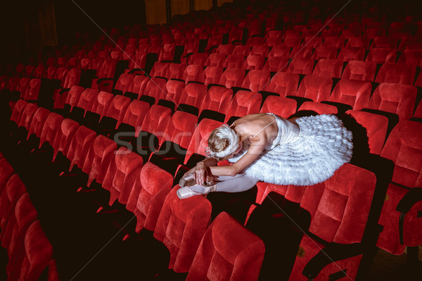 Ballerina sitting in the empty auditorium theater Stock photo © master1305