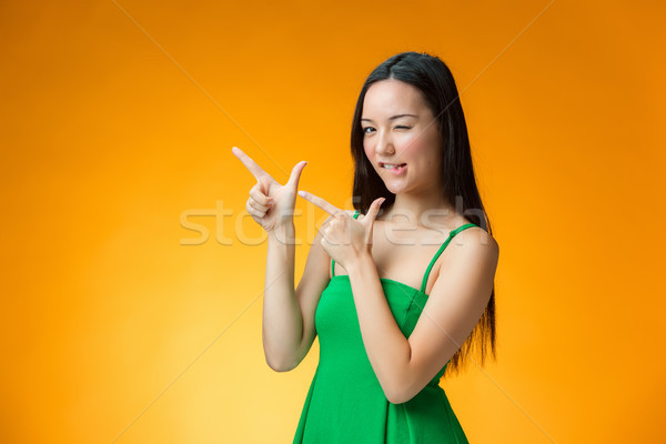 The happy Chinese girl on yellow background Stock photo © master1305