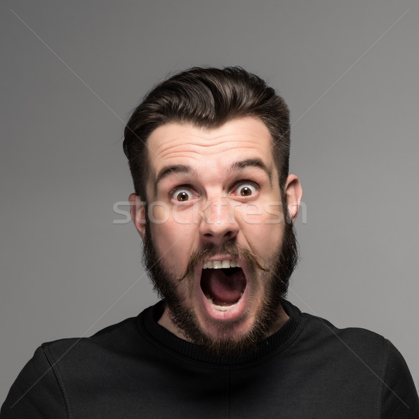 Portrait of a young surprised businessman with opened mouth Stock photo © master1305