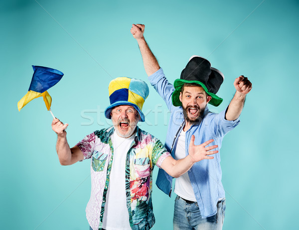 The two football fans with a flag of Ukraine over blue Stock photo © master1305