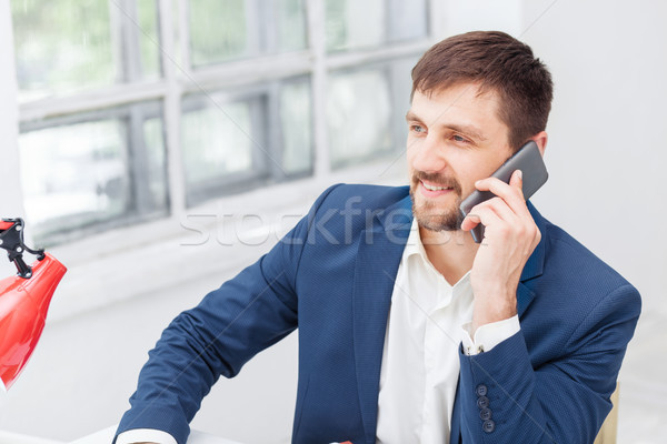 Portrait of businessman talking on phone in office Stock photo © master1305