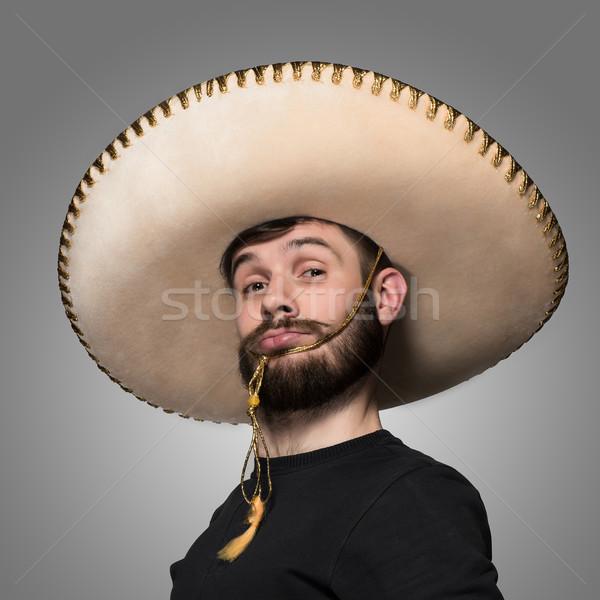 Ritratto divertente uomo mexican sombrero grigio Foto d'archivio © master1305