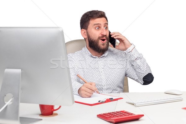 Portrait of businessman talking on mobile phone in office Stock photo © master1305