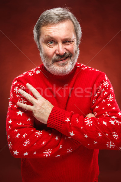 The expressive portrait on red background of a pouter man  Stock photo © master1305