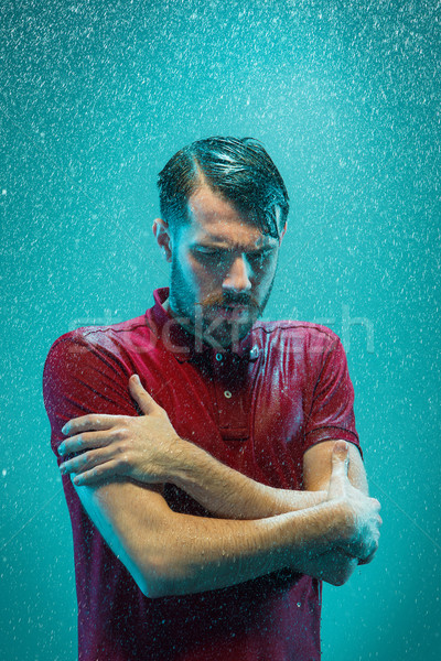 The portrait of young man in the rain Stock photo © master1305