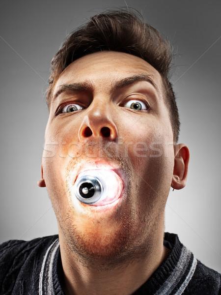 Caucásico hombre bombilla boca gris funny Foto stock © master1305