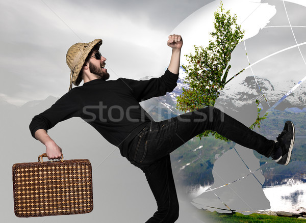 man wtih suitcase ready to travel as tourist on gray background Stock photo © master1305