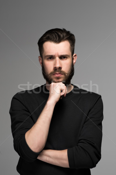 Fashion portrait of young man in black  Stock photo © master1305