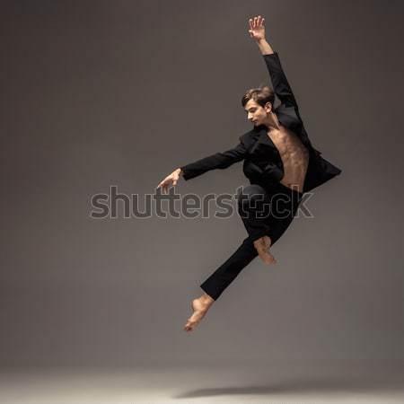 Foto stock: Jovem · atraente · moderno · bailarino · saltando · branco