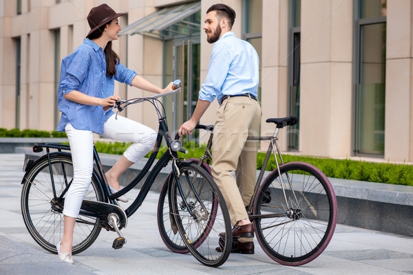 Romantic date of young couple on bicycles Stock photo © master1305