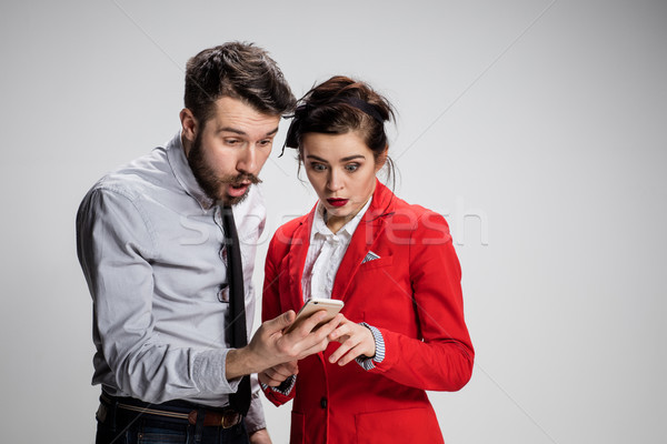 Stockfoto: Business · twee · jonge · collega's · mobiele · telefoon