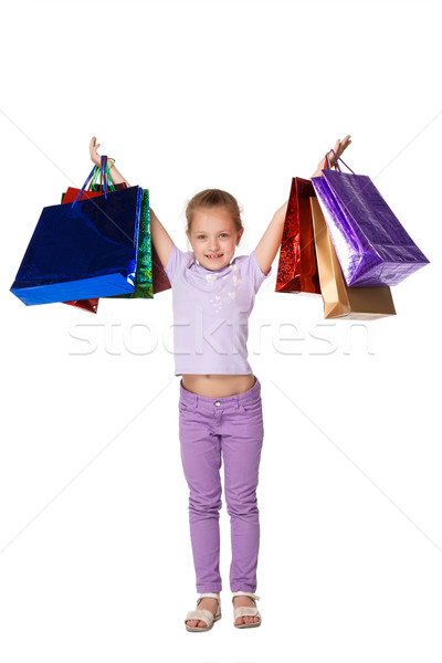 Happy girl with shopping bags standing at studio  Stock photo © master1305