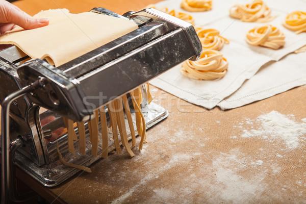 The fresh pasta and  machine on kitchen table Stock photo © master1305