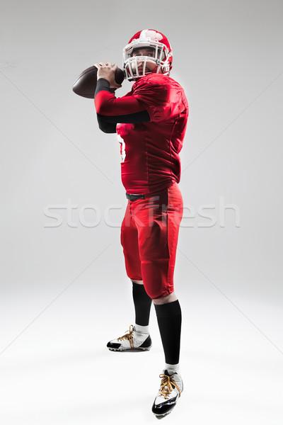 Amerikai futballista pózol labda fehér kaukázusi Stock fotó © master1305