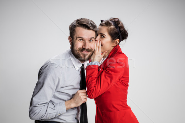 Young man telling gossips to his woman colleague at the office Stock photo © master1305