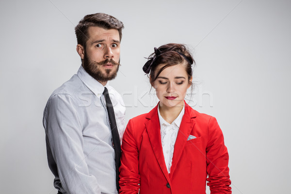 The business man and woman conflicting on a gray background Stock photo © master1305
