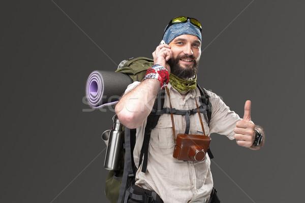 肖像 男 遊客 微笑 背包 電話 商業照片 © master1305