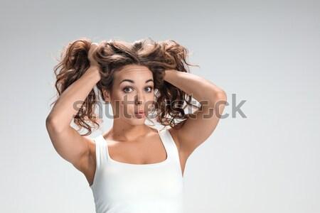 Kobieta włosy wiatr szary twarz Zdjęcia stock © master1305