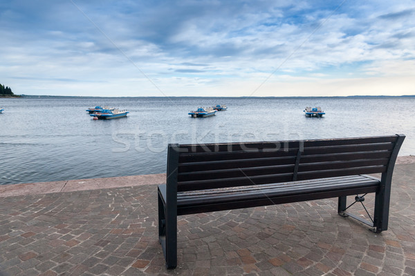 Wood bench at the Garda lake Stock photo © master1305