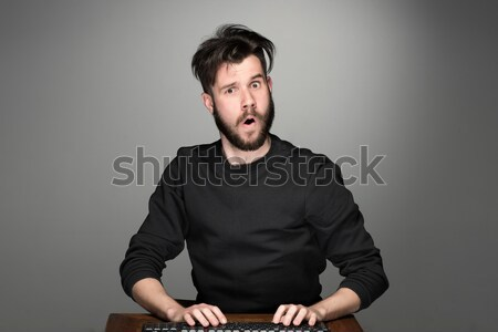 Crazy бизнесмен сидят таблице серый рук Сток-фото © master1305