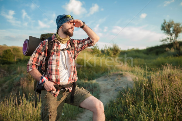 Young caucasian man with backpack walking on the top of hill Stock photo © master1305