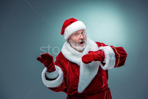 Kerstman presenteren iets Blauw man gelukkig Stockfoto © master1305