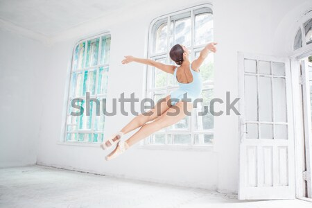 Stock photo: young modern ballet dancer jumping on white background